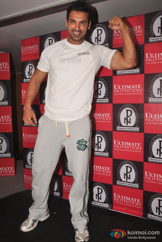 John Abraham flexes his biceps
