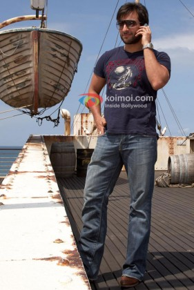 Saif Ali Khan talks on the phone in Race Movie