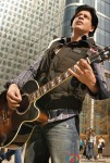 Shah Rukh Khan playing a guitar