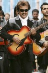 Rajnikanth strums the guitar in Sivaji - The Boss Movie