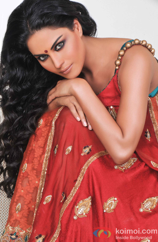 Veena Malik in a red Desi avtar