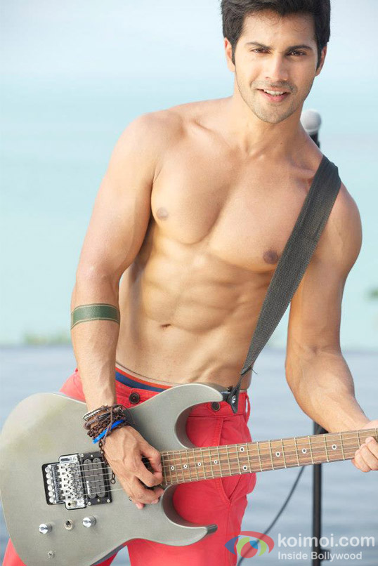Hot hunk Varun Dhawan poses with a guitar in Student Of The Year Movie Stills