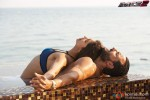 Deepika Padukone and Saif Ali Khan chilling by the pool sid in Race 2 Movie Stills