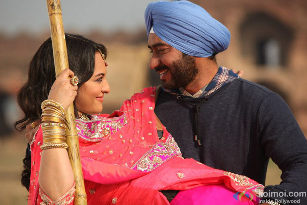 Sonakshi Sinha and Ajay Devgn in a still from Son Of Sardaar (Son Of Sardar) Movie