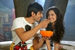 Kartik Tiwari offers a food to Nushrat Bharucha in Akaash Vani Movie Stills