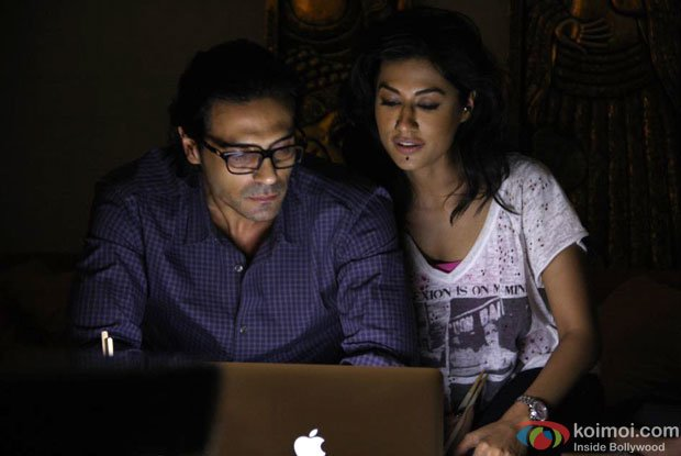 Arjun Rampal and Chitrangada Singh in Darmiyan Song in Inkaar Movie Stills