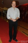 Anupam Kher poses on the red carpet