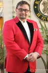Rishi Kapoor gives a dashing pose in Red suit