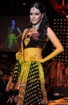 Neha Dhupia walks the ramp at fashion show