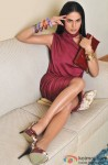 Veena Malik Captured In Her Maroon Silken Towel dress