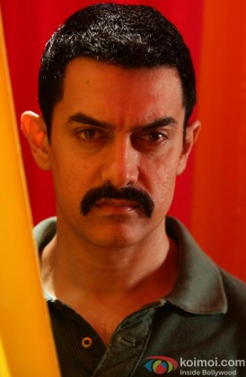 A serious Aamir Khan looks on