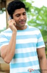 Farhan Akhtar Captured During A Phone Call In A Still From His Film