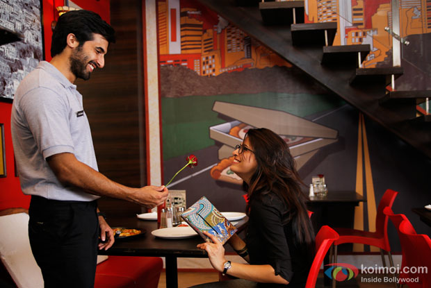 Akshay Oberoi and Parvathy Omanakuttan in a still from movie 'Pizza'