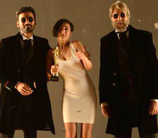 Dhanush, Akshara Haasan and Amitabh Bachchan in a 'Sha Sha Sha Mi Mi Mi' song still from movie 'Shamitabh'