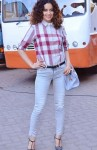 Kangana Ranaut in a chequered Burberry shirt and light colored denims