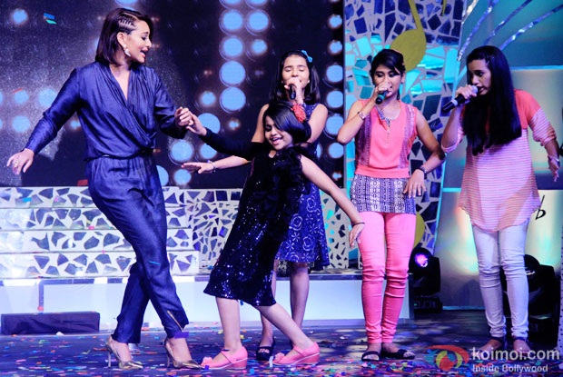 Sonakshi Sinha dance with contestant during the press conference of reality show Indian Idol Junior