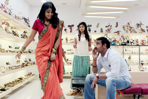 Shriya Saran and  Ajay Devgn in a still from movie 'Drishyam'