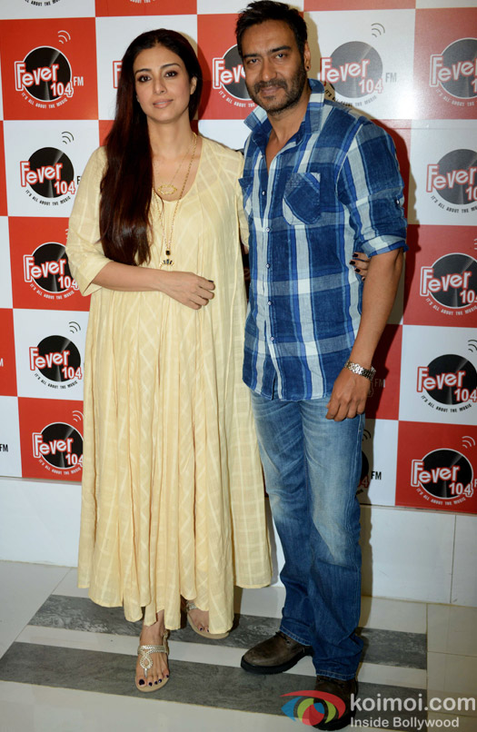 Tabu and Ajay Devgn during the promotion of movie Drishyam at Fever 104 FM