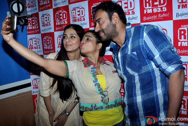 Tabu and Ajay Devgn during the promotion of movie Drishyam at Red FM 93.5