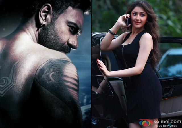 Ajay Devgn and Sayesha Saigal in a still from movie 'Shivaay'