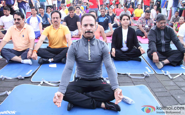 Mickey Mehta and Shaina NC during the International Yoga day